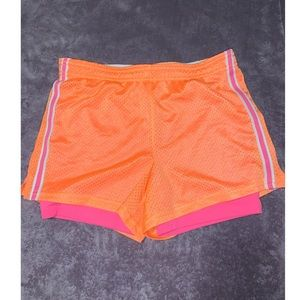 Bright Neon orange and pink athletic shorts